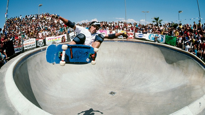 DEL MAR, CA - AUGUST 01: Chris Miller, riding for Gordan and Smith Skateboards, does a frontside ollie above the keyhole pool during competition as the National Skateboarding Association event at the Del Mar Skate Ranch in August 1985 in Del Mar, California. (Photo by Doug Pensinger/Getty Images)